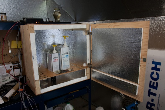 The inside of the hotbox. The walls are insulated with styrofoam insulation, the epoxy sits on the shelf, and the heating element is on the bottom.